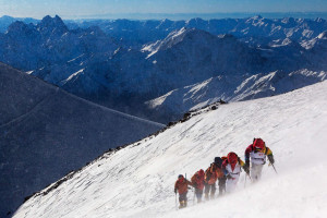 Torchbearers carrying the Olympic torch to the Mount Elbrus