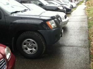 cars on sidewalk at 16th ave s