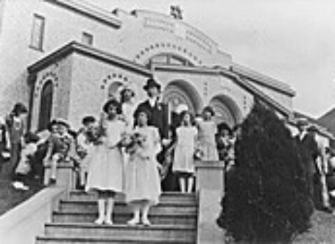 The Ezra Bessaroth building on the same site in 1924, a wedding party posted on the steps